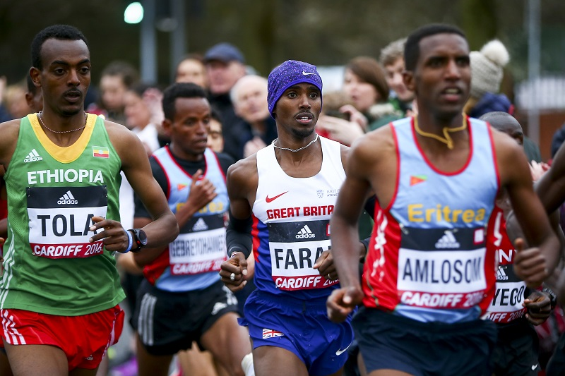 """CARDIFF, WALES - MARCH 26: Mo Farah of Great Britain (C) competes in the Men's Half Marathon during the IAAF/Cardiff University World Half Marathon Championships on March 26, 2016 in Cardiff, Wales. (Photo by Jordan Mansfield/Getty Images for IAAF)"""